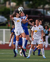 In a National Women's Soccer League Elite (NWSL) match, the Boston Breakers defeated the Western New York Flash  2-1, at Dilboy Stadium on May 5, 2013.  Western New York Flash midfielder Carli Lloyd (10) and Boston Breakers midfielder Joanna Lohman (11) compete for a head ball as Abby Wambach stands by.