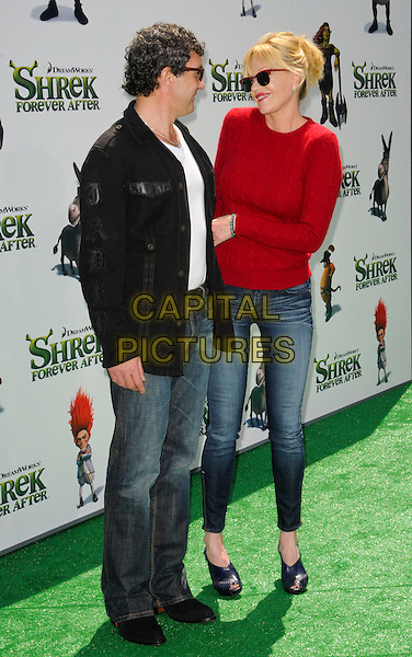 "ANTONIO BANDERAS & MELANIE GRIFFITH .at DreamWorks Animation's ""Shrek Forever After"" L.A. Film Premiere held at Gibson Amphitheatre at Universal CityWalk, Universal City, California, USA, May 16th, 2010. .arrivals full length red jumper cable knit sweater ray bans sunglasses wayfarers jeans black jacket white t-shirt married couple husband wife jeans .CAP/ROT.©Lee Roth/Capital Pictures"