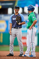 Trenton Thunder first baseman Gosuke Katoh (19) talks with Dom Nunez (9) during a game against the Hartford Yard Goats on August 26, 2018 at Dunkin' Donuts Park in Hartford, Connecticut.  Trenton defeated Hartford 8-3.  (Mike Janes/Four Seam Images)