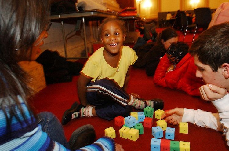 tutoring3/011403 -- House Pages Alejandra Lopez and Christopher Katsaros, both 16, play blocks with Timmia Devine, 6, during a Monday night tutoring session in Cannon sponsered by Horton Kids and Hill Help.