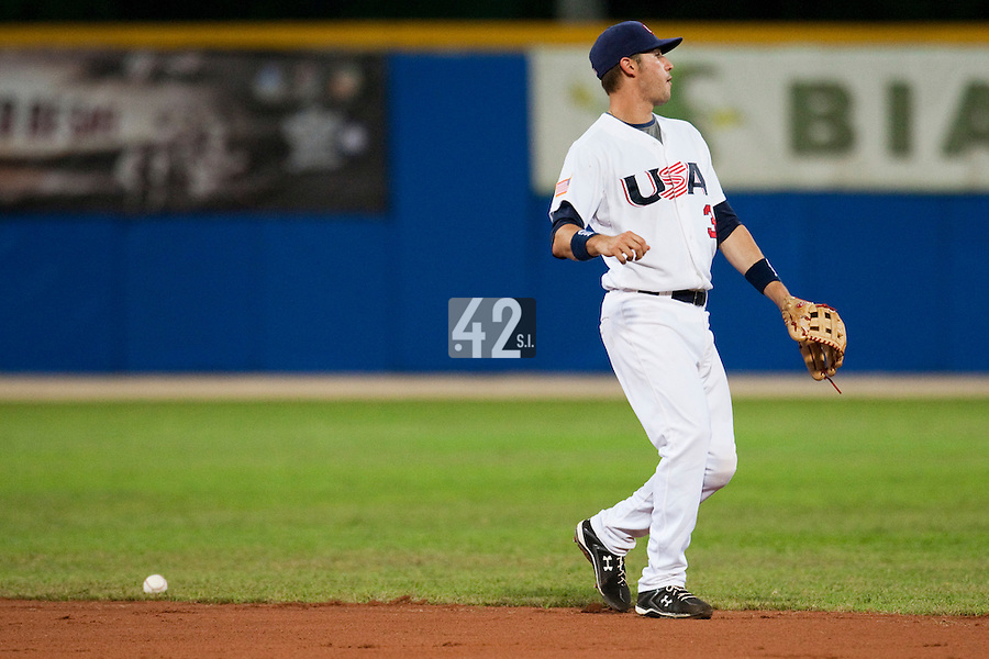 24 September 2009: Trevor Plouffe of Team USA reacts as he fails to catch the ball during the 2009 Baseball World Cup final round match won 5-3 by Team USA over Cuba, in Nettuno, Italy.