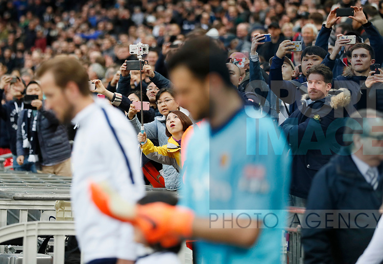 Fans take pictures on their phones during the premier league match at Wembley Stadium, London. Picture date 30th April 2018. Picture credit should read: David Klein/Sportimage