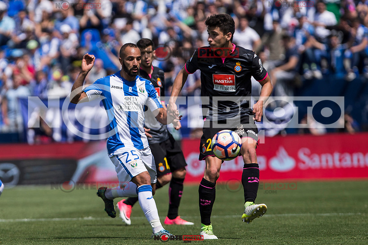 El Zhar of Club Deportivo Leganes competes for the ball with Diego Reyes of RCD Espanyol during the match of La Liga between  Club Deportivo Leganes and RCD Espanyol at Butarque  Stadium  in Leganes, Spain. April 16, 2017. (ALTERPHOTOS / Rodrigo Jimenez)