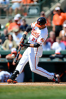 Baltimore Orioles outfielder Nick Markakis #21 during a Spring Training game against the New York Mets at Ed Smith Stadium on March 30, 2013 in Sarasota, Florida.  (Mike Janes/Four Seam Images)