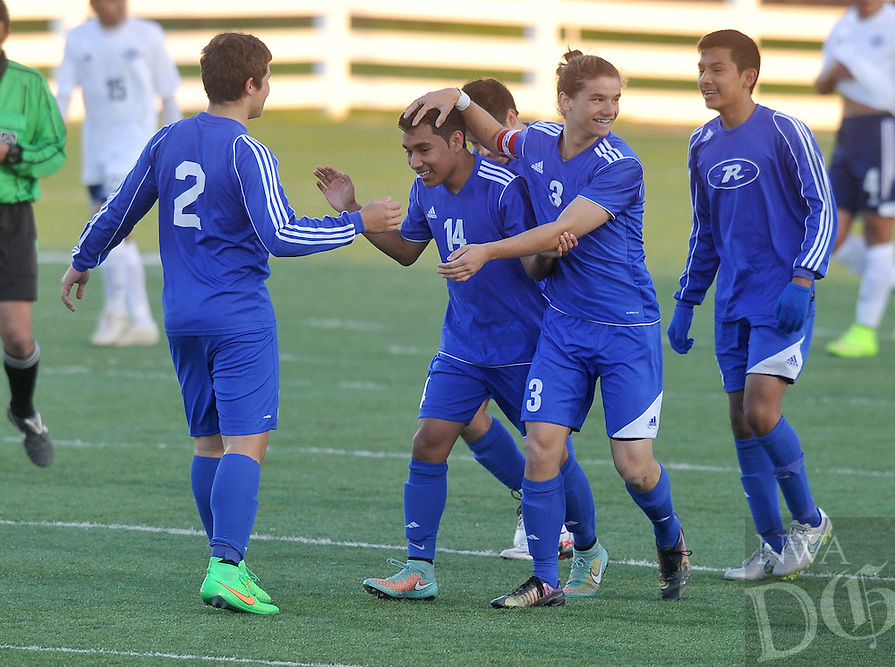 NWA Democrat-Gazette/Michael Woods --04/03/2015--w@NWAMICHAELW... Rogers players Alex Valdez (2) Horacio Olvera (14) Wilson Valdez (3) and Alex Balderas (19) celebrate after the Mountie's second goal in the first half of Friday nights game at Har-Ber High School in Springdale.