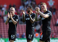 (L-R) Oliver McBurnie, Kyle Bartley and Alfie Mawson of Swansea City thank away supporters at the end of the game during the Premier League match between Southampton and Swansea City at the St Mary's Stadium, Southampton, England, UK. Saturday 12 August 2017