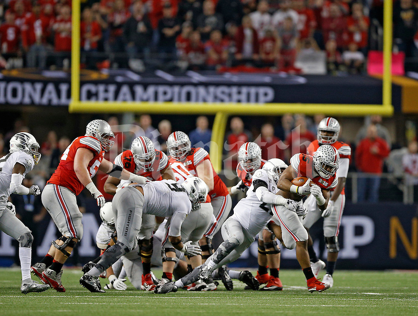 Ohio State Buckeyes running back Ezekiel Elliott (15) carries the ball up the middle against Oregon Ducks defense during the 3rd quarter in College Football Playoff Championship game at AT&T Stadium in Arlington, Texas on January 12, 2015.  (Dispatch photo by Kyle Robertson)