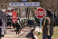Pictured: Greek riot police gather by the barb wired border. Sunday 01 March 2020<br /> Re: Clashes between migrants and riot police at the Greek-Turkish border of Kastanies near Evros, Greece