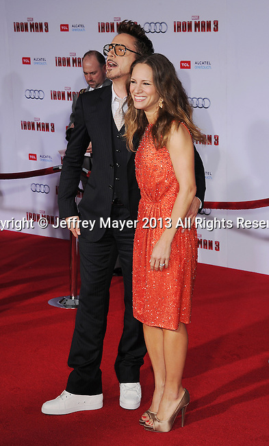 HOLLYWOOD, CA- APRIL 24: Actor Robert Downey Jr. and wife Susan Downey arrive at the 'Iron Man 3' - Los Angeles Premiere at the El Capitan Theatre on April 24, 2013 in Hollywood, California.