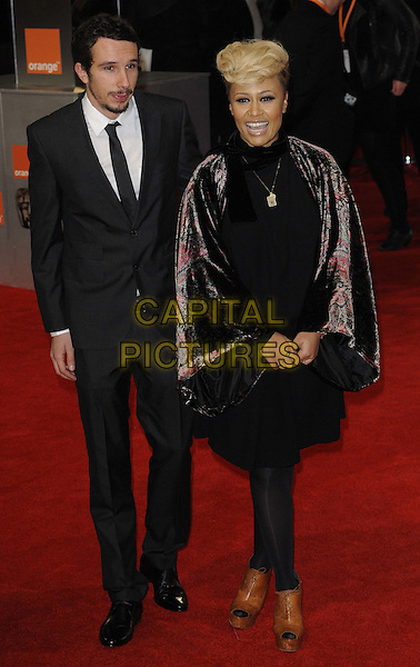 guest & Emeli Sande.The Orange British Academy Film Awards ( BAFTA ), Royal Opera House, Bow St., London, England..February 12th, 2012.baftas full length black suit sleeves pink print tights dress brown platform shoes peep toe .CAP/CAN.©Can Nguyen/Capital Pictures.