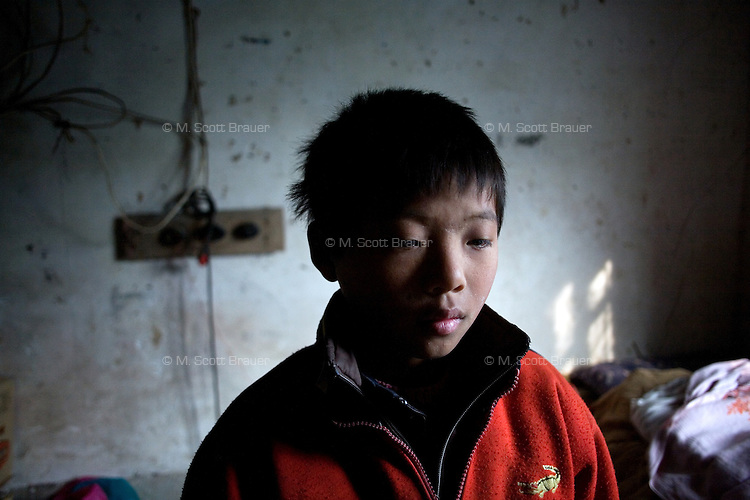 Yang Zhou was orphaned in 2003 and now lives with his grandparents in rural Hu He Village, Jiangsu Province, China.  The boy's father died of asthma complications in 2002, and his mother remarried in 2003, abandoning him.  Yang Zhou's grandparents are both over 70 and cannot support him; his grandmother has a gastric illness, and his grandfather has a cerebral embolism and the meager income they earn from farming does not support the family...At the time of these pictures, China's Amity Foundation charity, was investigating the family's situation in preparation to raise money to financially support these children and other orphans in similar situations.  With Amity's support, each orphan, aged 6-12, would receive approximately 1,400 RMB annually (about 200 USD) to pay for the cost of living. Amity works to keep children out of the institutional orphanages in China, preferring to provide monetary assistance that can help maintain a family environment for the orphans it helps.  .