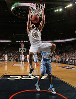 Virginia guard Justin Anderson (1) dunks the ball during an NCAA basketball game against Virginia Monday Jan. 20, 2014 in Charlottesville, VA. Virginia defeated North Carolina 76-61.