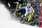 "A skier competes during the first run of the Men's Slalom at the FIS Alpine Ski World Cup Men's in Kitzbuehel, on January 24, 2016. Hans ""Hansi"" Hinterseer made also the inspection."