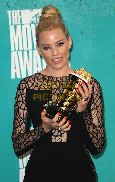 Elizabeth Banks.2012 MTV Movie Awards held at the Gibson Amphitheatre, Universal City, California, USA..3rd June 2012.half length black dress sheer pattern hair up bun jumpsuit award trophy winner pink nail varnish polish .CAP/ADM/SLP/LS.©Lee Sherman/Starlitepics/AdMedia/CapitalPictures.