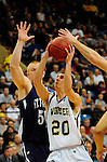19 MAR 2011: Guard Ryan Snyder (20) of Wooster drives to the hoop during the Division III Men's Basketball Championship held at the Salem Civic Center in Salem, VA. The University of St. Thomas (Minnesota) defeated College of Wooster 78-54 to win the national title.  Andres Alonso/NCAA Photos