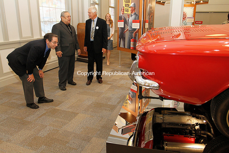 WINSTED, CT - 26 SEPTEMBER 2015 - 092615JW12.jpg -- ACLU of Connecticut Executive Director Stephen Glassman, museum consultant Bill Koldys, and ACLU of Connecticut President Andy Schatz look over a Corvair display during the opening of the American Museum of Tort Law Saturday morning. Jonathan Wilcox Republican-American