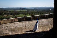 A man walks to the church in preparation for the Holy Week procession in Aracena.