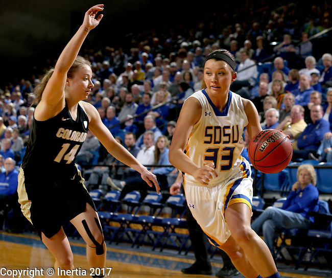 BROOKINGS, SD - MARCH 19:  Sydney Tracy #33 from South Dakota State looks to make a move around Kennedy Leonard #14 from Colorado during their second round WNIT game at Frost Arena March 19, 2017 in Brookings, South Dakota. (Photo by Dave Eggen/Inertia)