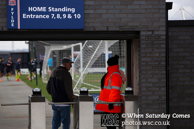 AFC Fylde 1, Aldershot Town 0, 14/03/2020. Mill Farm, National League. A home supporter entering the stadium via a turnstile before AFC Fylde took on Aldershot Town in a National League game at Mill Farm, Wesham. The fixture was played against the backdrop of the total postponement of all Premier League and EFL football matches due to the the coronavirus outbreak. The home team won the match 1-0 with first-half goal by Danny Philliskirk watched by a crowd of 1668. Photo by Colin McPherson.