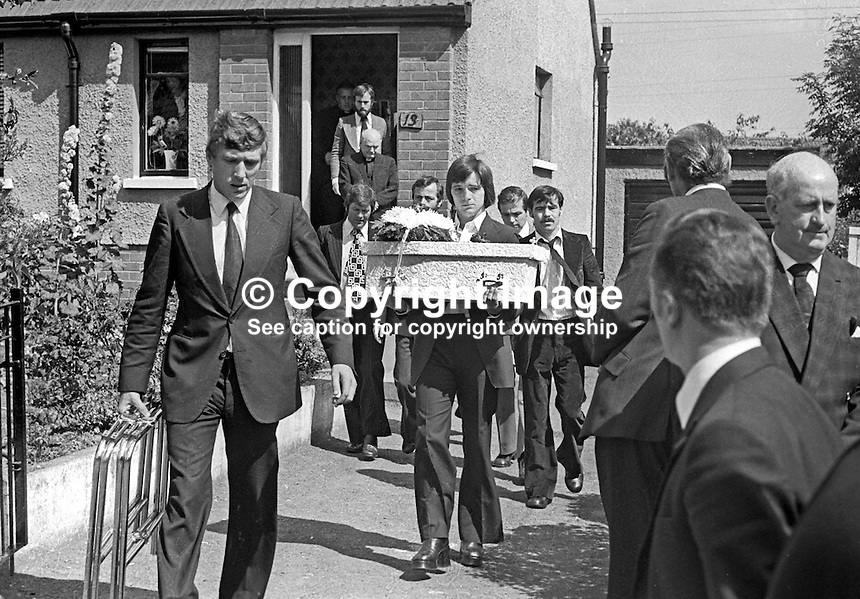 A family member carries the tiny coffin of one of the three children, Joanne, 8 years, John, 2 years, and Andrew, 6 weeks, who died as a result of one of the most tragic and horrific incidents of the N Ireland Troubles on 10th August 1976. A car driven by Daniel Lennon, aka Danny Lennon, member, Provisional IRA,  mounted the pavement and ploughed into the Maguire family. Lennon died at the wheel having been shot by British soldiers in hot pursuit. The incident gave rise to the birth of the Peace People organisation led by Mairead Corrigan, aunt of the dead children, and a local woman,Betty Williams. 197608130371g.<br /> <br /> Copyright Image from Victor Patterson, 54 Dorchester Park, Belfast, UK, BT9 6RJ<br /> <br /> t1: +44 28 9066 1296 (from Rep of Ireland 048 9066 1296)<br /> t2: +44 28 9002 2446 (from Rep of Ireland 048 9002 2446)<br /> m: +44 7802 353836<br /> <br /> e1: victorpatterson@me.com<br /> e2: victorpatterson@gmail.com<br /> <br /> The use of my copyright images is subject to my Terms &amp; Conditions.<br /> <br /> It is IMPORTANT that you familiarise yourself with them. They are available on my website at www.victorpatterson.com.<br /> <br /> None of my copyright images may be used on a website unless they are visibly watermarked, i.e. &copy; Victor Patterson within the body of the visible image. Metadata denoting my copyright must NOT be deleted. <br /> <br /> Web use (maximum size - 400 kb) is extra at currently recommended NUJ rates.