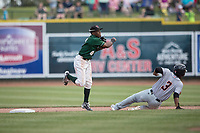 Great Lakes Loons shortstop Errol Robinson (8) turns a double play as Bowling Green Hot Rods baserunner Adrian Rondon (3) slides into second base during the Midwest League baseball game on June 4, 2017 at Dow Diamond in Midland, Michigan. Great Lakes defeated Bowling Green 11-0. (Andrew Woolley/Four Seam Images)