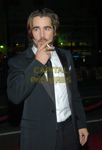 COLIN FARRELL.Alexander World Premiere held at Grauman's Chinese Theatre..16 November 2004.half length, black suit, jacket, smoking, cigarette.www.capitalpictures.com.sales@capitalpictures.com.© Capital Pictures.