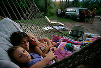 Children lay in a hammock during a family camping trip along the St. Marys River.