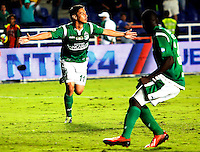 CALI -COLOMBIA-16-11-2013. Sergio Esteban Romero (Izq.) del Deportivo Cali celebra un gol en contra del Deportivo Pasto durante partido válido por la fecha 1 de los cuadrangulares de la Liga Postobón II 2013 jugado en el estadio Pascual Guerrero de la ciudad de Cali./ Deportivo Cali player Sergio Esteban Romero (L) celebrates a goal against Deportivo Pasto match valid for the 1th date of the quadrangulars of Postobon League II 2013 played at Pascual Guerrero stadium in  Cali city.Photo: VizzorImage/Juan C. Quintero/STR