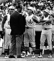 Felipe Alou, Mgr. John McNamara and Campy Campan eris argue with home plate umpire (1970 photo by.Ron Riesterer)
