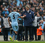 Manuel Pellegrini manager of Manchester City congratulates Pablo Zabaleta of Manchester City - UEFA Champions League group E - Manchester City vs Bayern Munich - Etihad Stadium - Manchester - England - 25rd November 2014  - Picture Simon Bellis/Sportimage