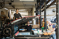 A 19th-century Paris printworks is defying its age and serving as a creative hub for contemporary artists. It takes three people to operate each press.