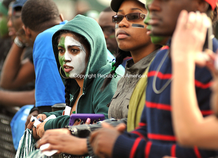 WATERBURY, CT, 14 OCTOBER 2011-101411JS03-Preya Persaud of New York City, a freshman at Post University, watches Post University in their only home game against Princton Friday at Municipal Stadium in Waterbury, Persaud was at the game with fellow Post University freshmen students Tameisha Edwards and Ashley Alston. <br />  Jim Shannon Republican-American