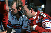AVONDALE, AZ - APRIL 15: Bobby Rahal (right) and engineer Adrian Newey in the pit lane before the Dana Jimmy Bryan 150 on April 15, 1984, at Phoenix International Raceway near Avondale, Arizona.