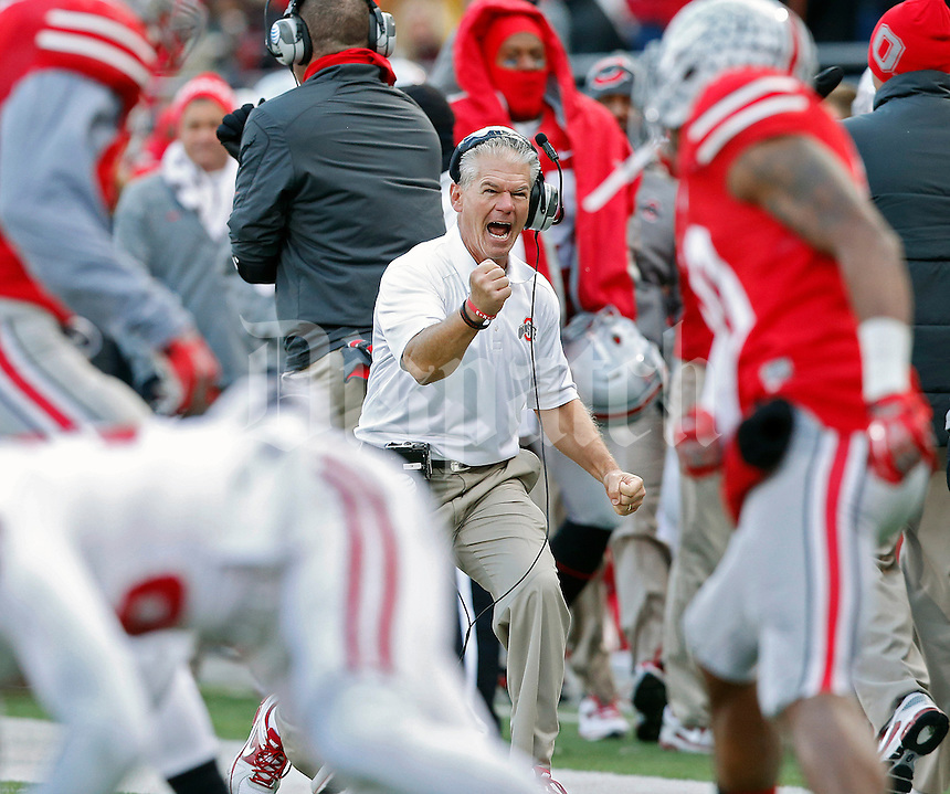 Ohio State Buckeyes special teams coordinator Kerry Coombs celebrates after a blocked punt on Indiana Hoosiers  during the second quarter of their College football game at Ohio Stadium in Columbus, Ohio on November 23, 2013.  (Dispatch photo by Kyle Robertson)