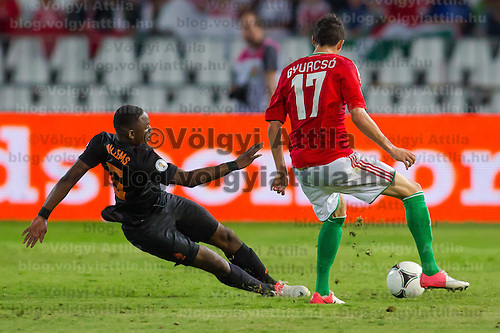 Netherlands' Jetro Willems (L) and Hungary's Adam Gyurcso (R) fight for the ball during a World Cup 2014 qualifying soccer match Hungary playing against Netherlands in Budapest, Hungary on September 11, 2012. ATTILA VOLGYI