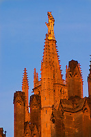 The Saint Andre Cathedral 11th 12th century with its majestic twin gothic towers in the evening at sunset on the place pey berland in Bordeaux, detail of the towers and the gold painted gilt statue of the madonna and child city Bordeaux Gironde Aquitaine France