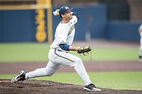 Michigan Wolverines pitcher Will Tribucher (22) delivers a pitch to the plate against the Maryland Terrapins on April 13, 2018 in a Big Ten NCAA baseball game at Ray Fisher Stadium in Ann Arbor, Michigan. Michigan defeated Maryland 10-4. (Andrew Woolley/Four Seam Images)