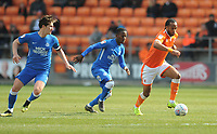 Blackpool's Nathan Delfouneso under pressure from Peterborough United's Siriki Dembele and Alex Woodyard<br /> <br /> Photographer Kevin Barnes/CameraSport<br /> <br /> The EFL Sky Bet League One - Blackpool v Peterborough United - Saturday 13th April 2019 - Bloomfield Road - Blackpool<br /> <br /> World Copyright &copy; 2019 CameraSport. All rights reserved. 43 Linden Ave. Countesthorpe. Leicester. England. LE8 5PG - Tel: +44 (0) 116 277 4147 - admin@camerasport.com - www.camerasport.com