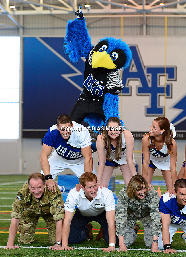 """PRINCE HARRY.takes part in American Football training at the US Air Force Training Academy, Colorado Springs_11/05/2013.The Prince also tried his hand at a cheerleader discipline..Prince Harry is on a week long USA visit the includes Washington, Denver, Colorado Springs, New Jersey, New York and Conneticut..Mandatory credit photo:©DIASIMAGES...NO UK SALES FOR 28 DAYS.(Failure to credit will incur a surcharge of 100% of reproduction fees)..**ALL FEES PAYABLE TO: """"NEWSPIX  INTERNATIONAL""""**..Newspix International, 31 Chinnery Hill, Bishop's Stortford, ENGLAND CM23 3PS.Tel:+441279 324672.Fax: +441279656877.Mobile:  07775681153.e-mail: info@newspixinternational.co.uk"""