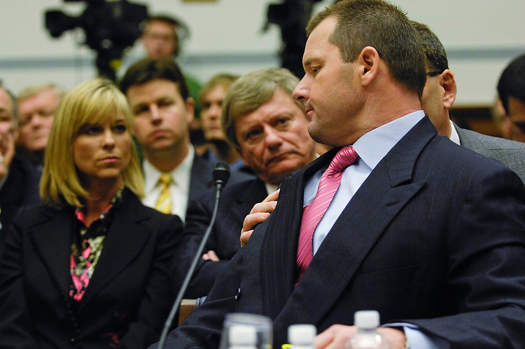 "WASHINGTON, DC - Feb. 13: Former Major League pitcher Roger Clemens consults attorneys Rusty Hardin and Larry Breuer during the House Oversight and Government Reform hearing on steroid use among MLB players. Clemens' wife, Debbie, is at left. The two key figures in an escalating investigation of doping in Major League Baseball came to Capitol Hill Wednesday to tell opposing stories, publicly and under oath, about whether a former ace pitcher used steroids and human growth hormone during his baseball career. Roger Clemens and former trainer Brian McNamee offered diametrically opposing accounts the hearing that Chairman Henry A. Waxman, D-Calif., had wanted to cancel. Waxman said in his opening remarks that after weeks of lengthy depositions by ballplayers, evidence drudged up by committee investigators, and a flurry of sworn affidavits, his instinct ""was to cancel the hearing and release a report."" But the panel went forward with the hearing at the behest of Clemens' attorneys, the chairman said. (Photo by Scott J. Ferrell/Congressional Quarterly)"