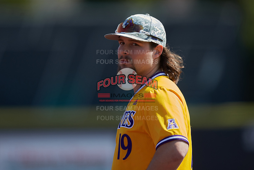 East Carolina Pirates first baseman Alec Burleson (19) on defense against the Charlotte 49ers at Hayes Stadium on March 8, 2020 in Charlotte, North Carolina. The Pirates defeated the 49ers 4-1. (Brian Westerholt/Four Seam Images)