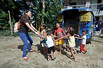 Deaconess Maria Jessica Cicillo sings with children in Mt. Heights, Philippines, where she works as a Christian educator for a nearby United Methodist Church. She is a graduate of Harris Memorial College.