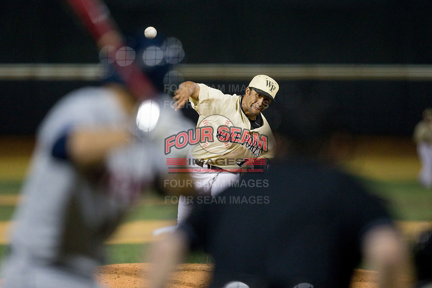 Wake Forest Demon Deacons relief pitcher Donnie Sellers (14) delivers a pitch to the plate against the UConn Huskies at Wake Forest Baseball Park on March 17, 2015 in Winston-Salem, North Carolina.  The Demon Deacons defeated the Huskies 6-2.  (Brian Westerholt/Four Seam Images)