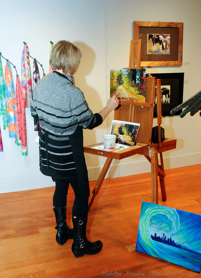 Artist Joan Hitchcock participates in the fall scene paint-off, organized by the Rectangle Gallery during Centralia, Washington's Third Thursday on October 20, 2016.