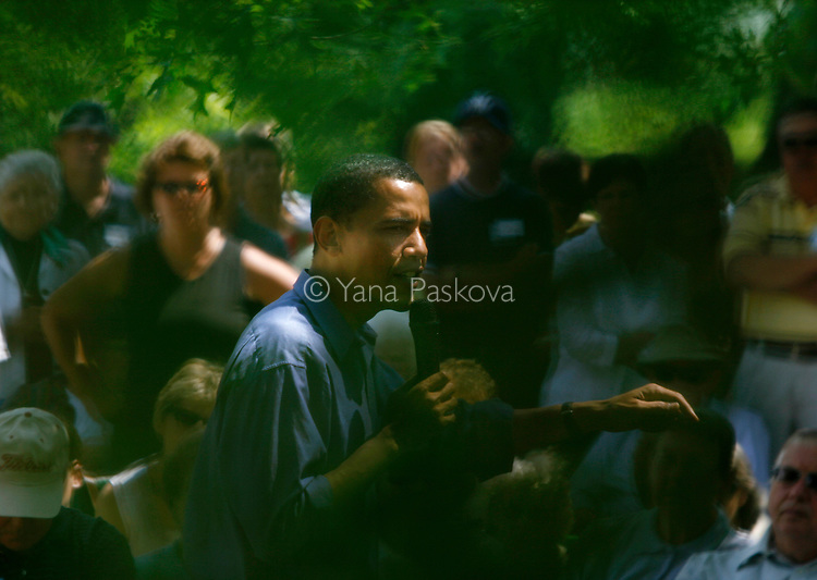 U.S. Democratic Presidential hopeful Barack Obama (D-IL) strolls amid greenery while speaking to potential voters in Manchester, IA, on July 14, 2007.