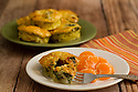 Mini quiche with spinach served with Mandarin orange sections