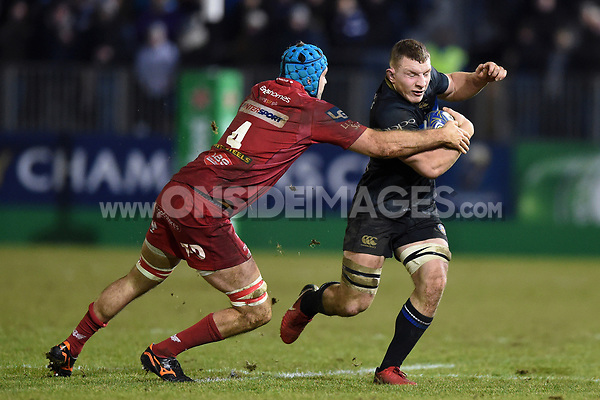 Sam Underhill of Bath Rugby takes on the Scarlets defence. European Rugby Champions Cup match, between Bath Rugby and the Scarlets on January 12, 2018 at the Recreation Ground in Bath, England. Photo by: Patrick Khachfe / Onside Images