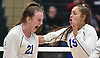 Emma McGovern #21 of Long Beach, left, and Lexie Correia #19 react as their team closes in on a 3-2 win over  Commack in the girls volleyball Class AA Long Island Championship at Farmingdale State College on Sunday, Nov. 11, 2018.