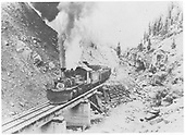RGS engine (either #455 or #461) with pilot snowplow hauling a freight across bridge 64-A in Burns Canyon.<br /> RGS  Burns Canyon, CO