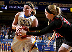 BROOKINGS, SD - MARCH 16:  Ellie Thompson #45 from South Dakota State University is tied up for a jump ball with Kelly Smith #25 from Northern Illinois during their first round WNIT game Thursday at Frost Arena in Brookings.(Photo by Dave Eggen/Inertia)